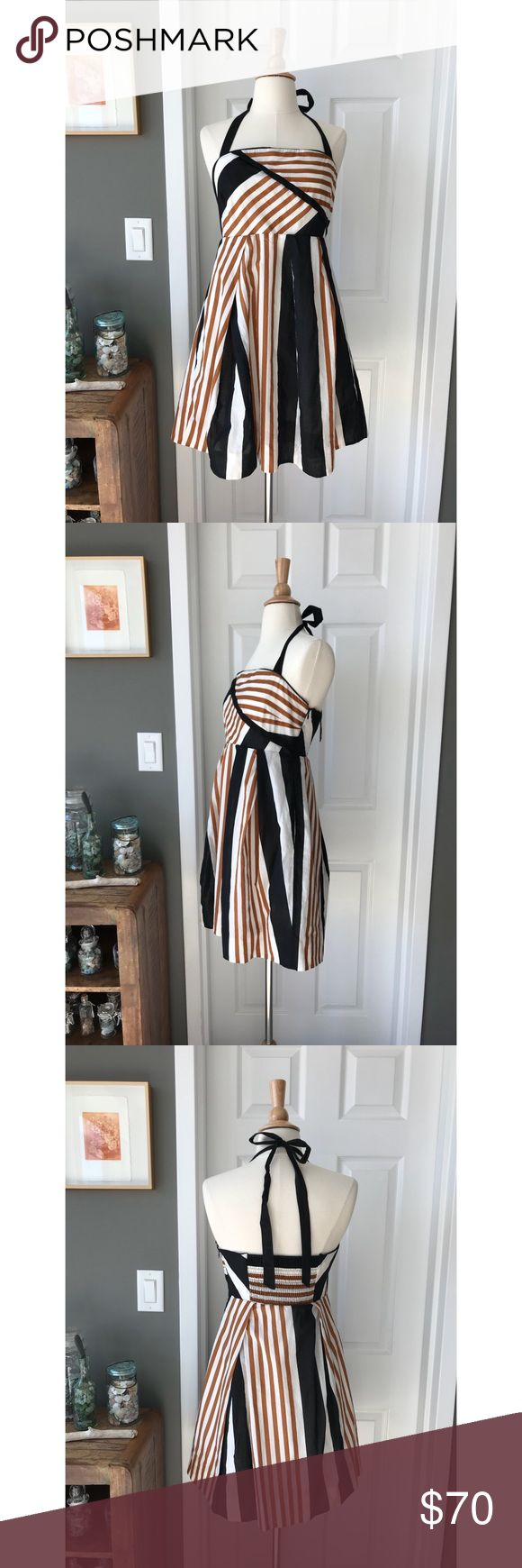Anthropologie stripe halter dress Made for summer neutral stripe halter dress from anthro. Has pockets and a grippy rubber seam at the bust line to ensure this is the most comfortable occasion dress you'll ever own. Size 6 petite and practically new. Anthropologie Dresses