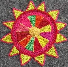 Hand embroidery by Swedish Ullabritt (evaullabritt at flickr) - detail of a cushion.    Her blog is called Bland garner, traser och trådar.