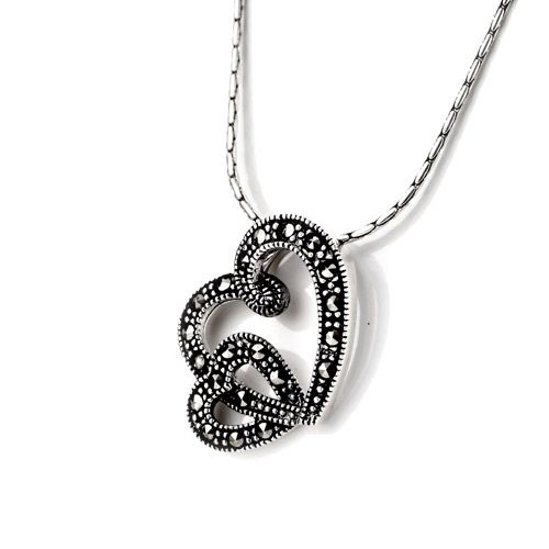 The use of delicate Marcasite gemstones in this double heart pendant give's it a vintage style, with subtle sparkle.