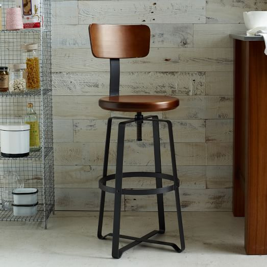 The perfect perch! With its solid wood swivel-seat and steel legs, the Adjustable Industrial Stool brings stripped-down, elemental style to kitchen islands, bars and counters. Its raw good looks work well in any setting, whether traditional or modern.