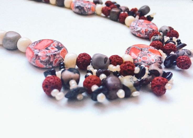 Unique one of a kind necklace made with lava beads, bone, red mosaic stone and crazy horse stone. https://www.etsy.com/ca/listing/265903985/red-cream-black-and-grey-earthy-boho