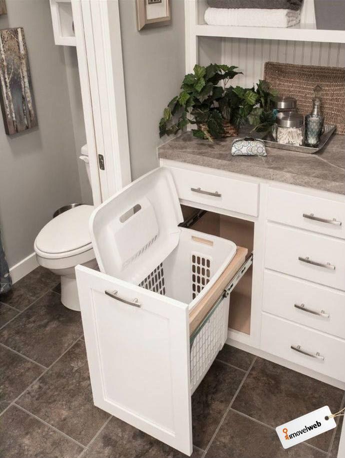 Genial a ideia do cesto de plástico no compartimento de roupa suja.