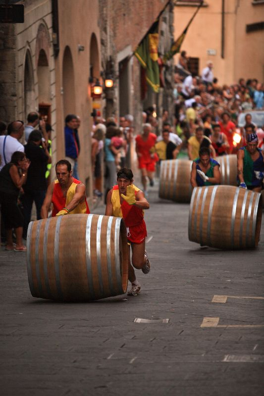 Bravio delle Botti: the great barrel race. This event takes place at the last Sunday of august, in the wonderful hilltop town of Montepulciano in Tuscany.