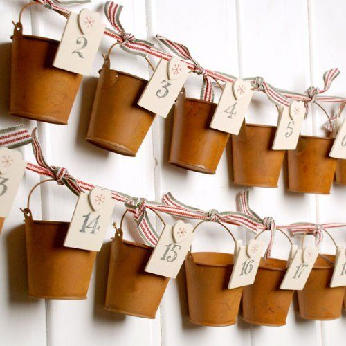 DIY advent calendar idea- I'm considering cones made from on hand card stock to keep the price down.