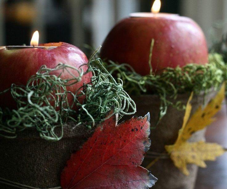 arrangement de pommes, feuilles automnales et fils de laine verte - déco de table créative