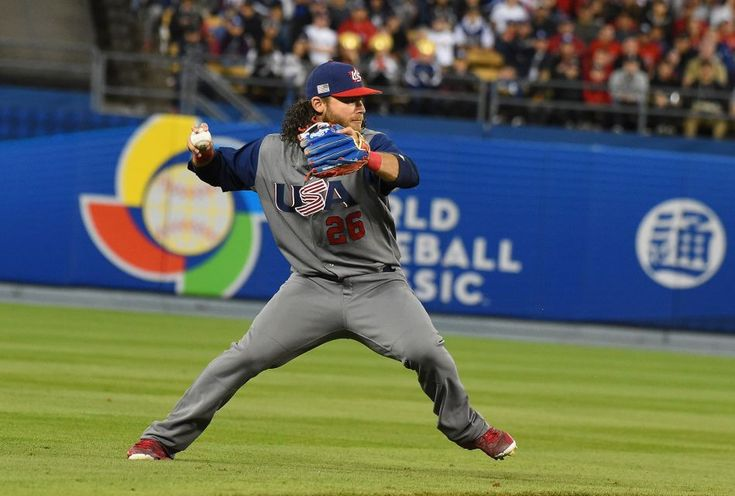 Brandon Crawford #26 of team United States fields a ball hits by Carlos Beltran #15 (not pictured)of team Puerto Rico and throws him out at first base in the fifth inning during Game 3 of the Championship Round of the 2017 World Baseball Classic at Dodger Stadium on March 22, 2017 in Los Angeles, California.