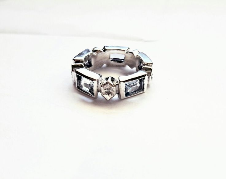Sterling silver Diamond and Topaz RingSterling Silver  Topaz and Diaomond Eternity Ring.