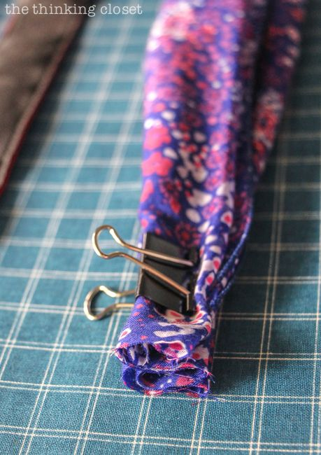 Prepping the scarf!  Just another step in the DIY Scarf Camera Strap Tutorial: Upcycle a scarf into a snazzy camera strap that will quickly become your new favorite accessory. This sewing tutorial will walk you through each step of the fun refashion. Happy Scarf Week 2015!