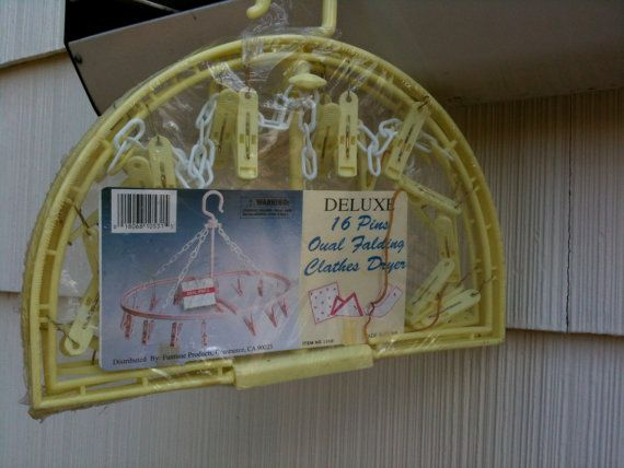 LOVE THIS.              Vintage Hanging Dry Rack Yellow with 16 Pins NOS by quinntrading, $13.00