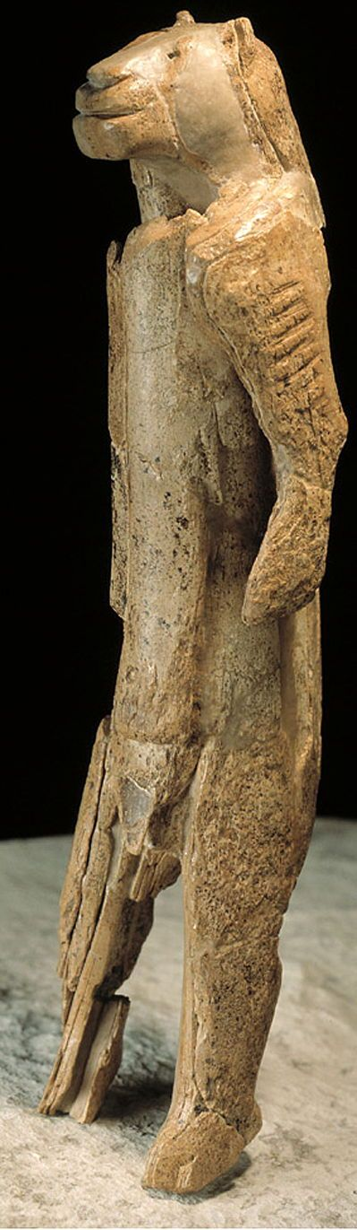 Lion man, Löwenmensch, carved from mammoth ivory, is 30 cm high and 6 cm in diameter. It was found in the cave of Hohlenstein-Stadel in the Valley of Lone, Baden-Wurttemberg (Germany), in 1931, recently dated to 40 000 BC making it the oldest sculpture known. It is now determined to be male. The arms bear striations carved into the ivory. It is pieced together from more than 1000 tiny pieces. Ulmer Museum. Ulm.