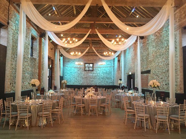 Winter wedding #thegranarybarns #barnwedding #suffolkvenue #barnvenue #drapes #weddingflowers