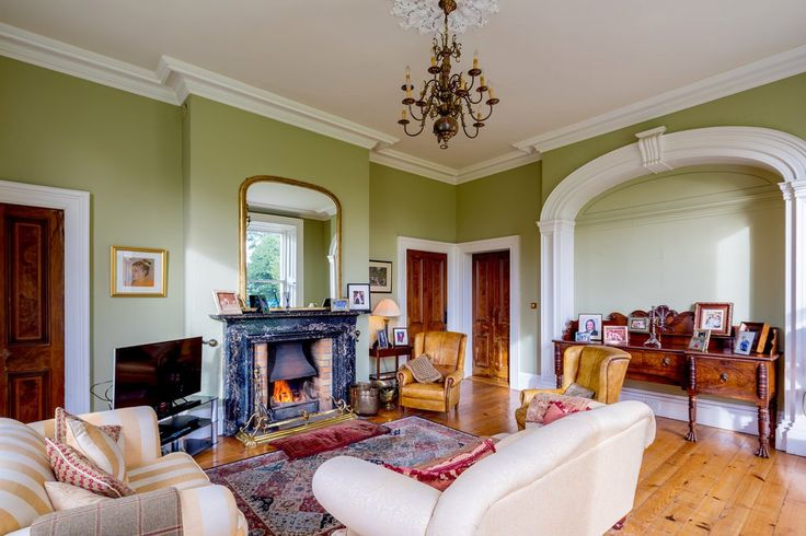 The%20living%20room%20has%20a%20black%20marble%20fireplace%20and,%20along%20with%20the%20rest%20of%20the%20house,%20retains%20its%20Victorian%20features,%20such%20as%20cornicing,%20molded%20arches%20and%20interior%20window%20shutters.%20Furniture%20is%20not%20included%20in%20the%20home%E2%80%99s%20asking%20price,%20but%20is%20negotiable.