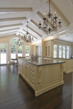 Traditional Kitchen with Vaulted Ceiling, Wrought Iron Chandeliers, Oak  Wood Floor, and Center Island Love the rafters.