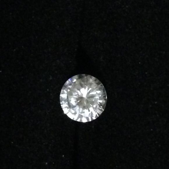 1 karat , free standing cubic zirconia . Without a setting, a man made diamond to be put into your own design of jewelry. Jewelry