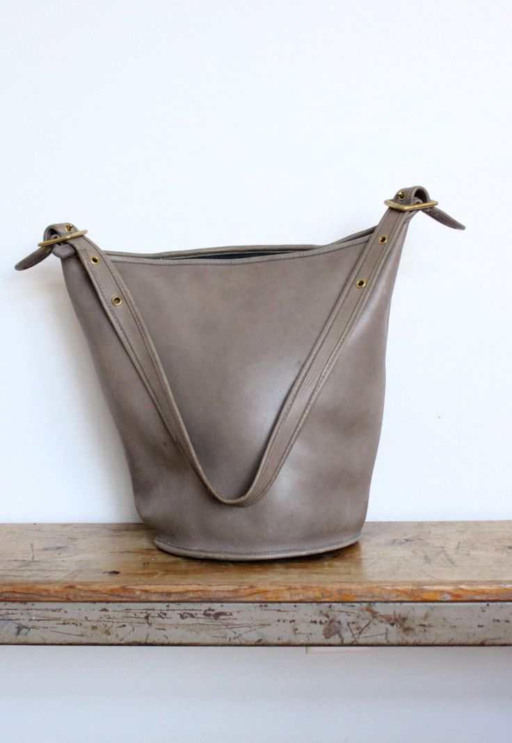 Vintage Coach Duffle Bag New York City Gray Tan RARE // Bucket Bag Feed Sac Pre 9085 NYC by magnoliavintageco on Etsy https://www.etsy.com/listing/268891524/vintage-coach-duffle-bag-new-york-city
