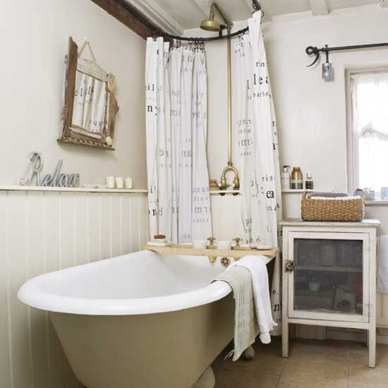 RusTic c0TTage Bath  From cute country accessories and aged storage units to iron curtain poles and a roll-top bath, this bathroom oozes cute cottage charm. The freestanding bath remains the focal point. Fit a rectangular shower rail and attach curtains on either side of the shower head to achieve this look, and paint the outside of the bath in a shade to match your scheme.