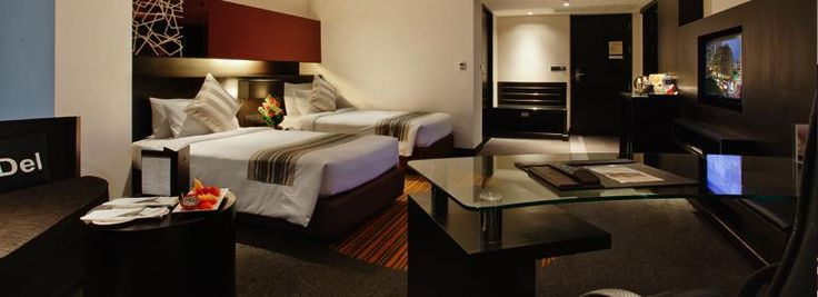 Deluxe room with twin beds in Golden Tulip Mandison Suites, a boutique hotel in Sukhumvit - Bangkok's business and entertainment centre.