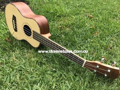Tenor Spruce Top ukulele, Laser Engraved sound hole with abalone top binding and turtle shell side binding.