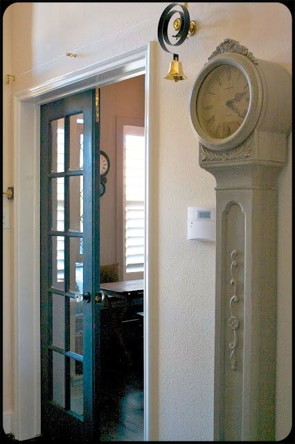 Interior French door, grandfather clocks, and that BELL!