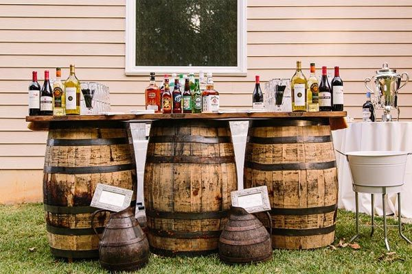 Be inspired by this DIY bar setup, a creative addition to your outdoor rustic wedding.
