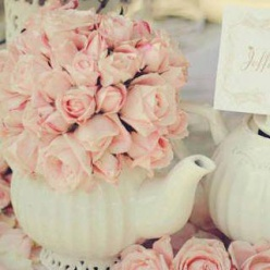 English garden themed wedding must-haves include little pink roses, teapots, stone statues, & ivy. So sweet!