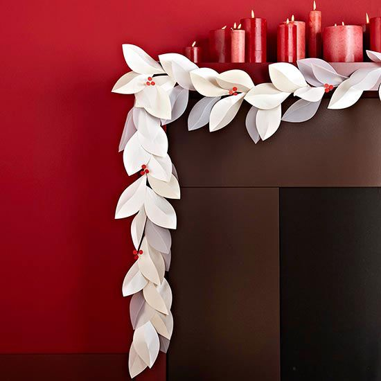 This pretty leaf garland is made out of paper! Ready the how-to: http://www.bhg.com/christmas/garlands/holiday-garland-ideas/#page=11