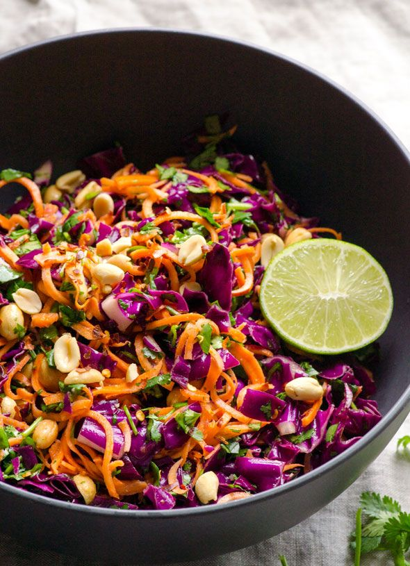 Sweet potato noodles salad with lime, peanuts, cilantro and red cabbage.