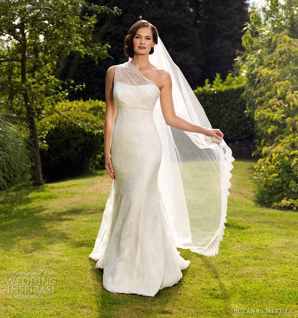 Aphrodite lace, satin and silk organza gown with one shoulder, and a soft floaty skirt with train.