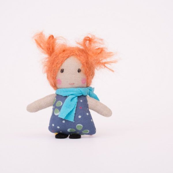 Approximately 7 cm tall, handmade mini ragdoll. Her body is made of linen, the dress is sewn of cotton, the face is hand-embroidered. Her hair is sewn thread by thread to her head with mohair yarn. The cotton scarf goes nicely with the dress.