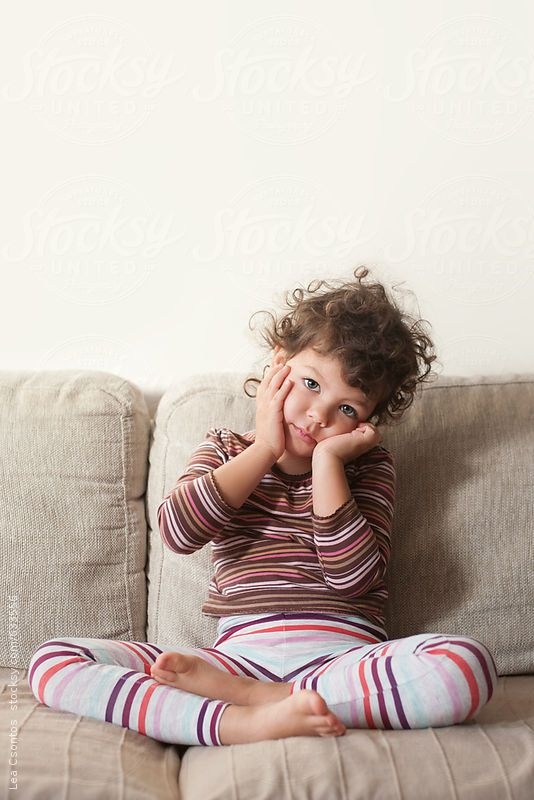Cute little girl early in the morning with bed hair - Lea Csontos for Stocksy United