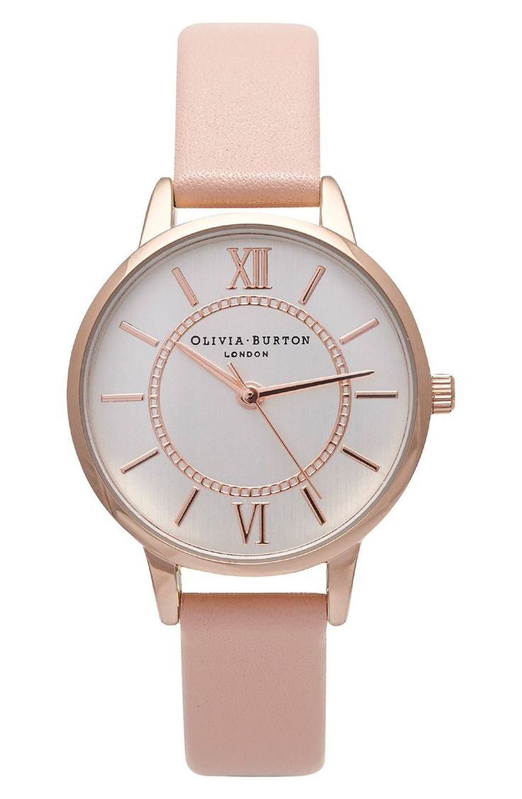 Polished indexes and a coordinating inner track mark the dial of this charming round watch that's balanced on a smooth pink leather strap.