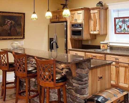 Raised Hickory Kitchen Cabinets With Gray Counter Tops