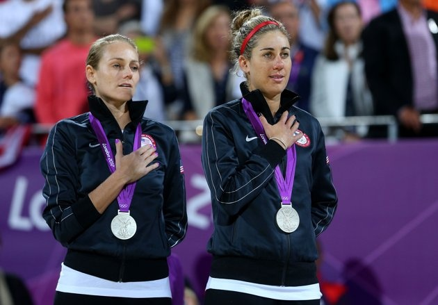 Silver medallists Jennifer Kessy (L) and April Ross of the United States celebrate on the podium during the medal ceremony for the Women's Beach Volleyball on Day 12 of the London 2012 Olympic Games at the Horse Guard's Parade on August 8, 2012 in London,