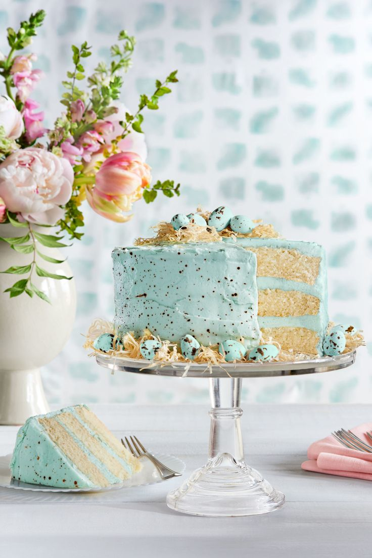 White cake with coconut buttercream frosting, this would be pretty (without the eggs) for Mother's day or a wedding shower