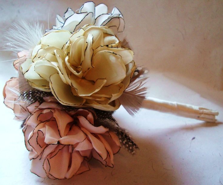 Another awesome way to do fabric flowers - tutorial at http://www.weddingbee.com/2010/07/27/diy-fabric-flower-bouquet/