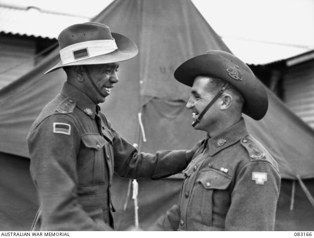 Lt R. W. Saunders and Lt T. C. Derrick congratulate each other following their graduation from officer training school, Seymour, Victoria, November 1944. Lt Saunders was the first Aborigene promoted to officer