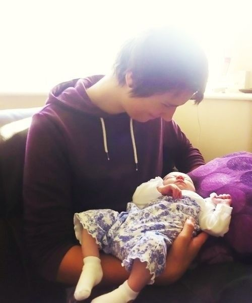 Dan Howell and baby! While it is incredibly adorable, he really doesn't know how to hold one...