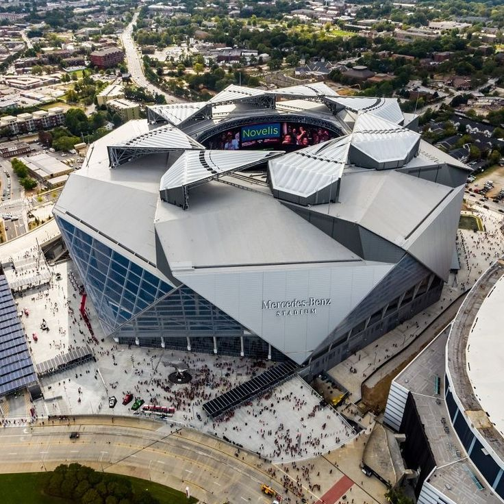 The Mercedes Benz stadium is the first professional sports stadium to achieve platinum LEED status. It achieved this certification with: 4000 solar panels most of which are visible to fans e.g. as parking lot canopies. LED lighting throughout Three nearbylight rail stations a bike valet program EV charging stations and new walking paths. Rainwater harvesting and underground water storage for irrigation and flood prevention along with water efficient fixtures.   . . . #eco #tech #stuff #green…