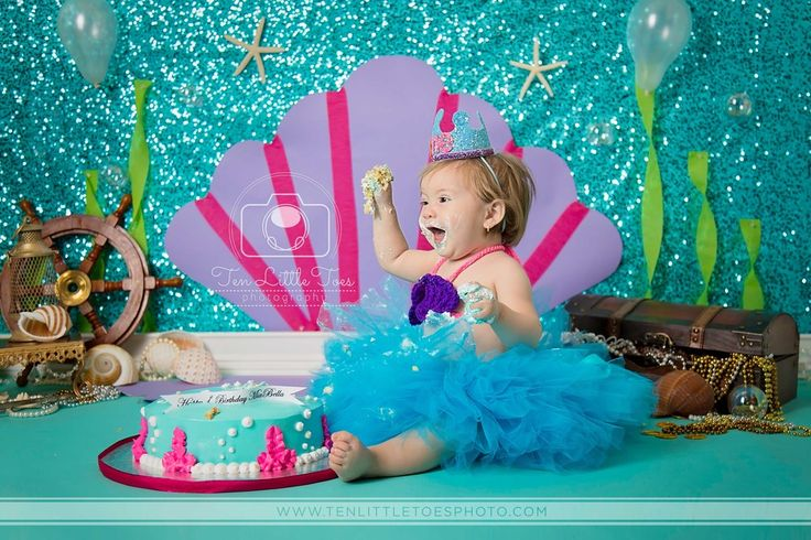 Everything's better, under the sea! :) This elaborate Little Mermaid themed photo shoot features our Teal Sequin Fabric Backdrop for an aquatic look. Photo courtesy of Ten Little Toes Photography