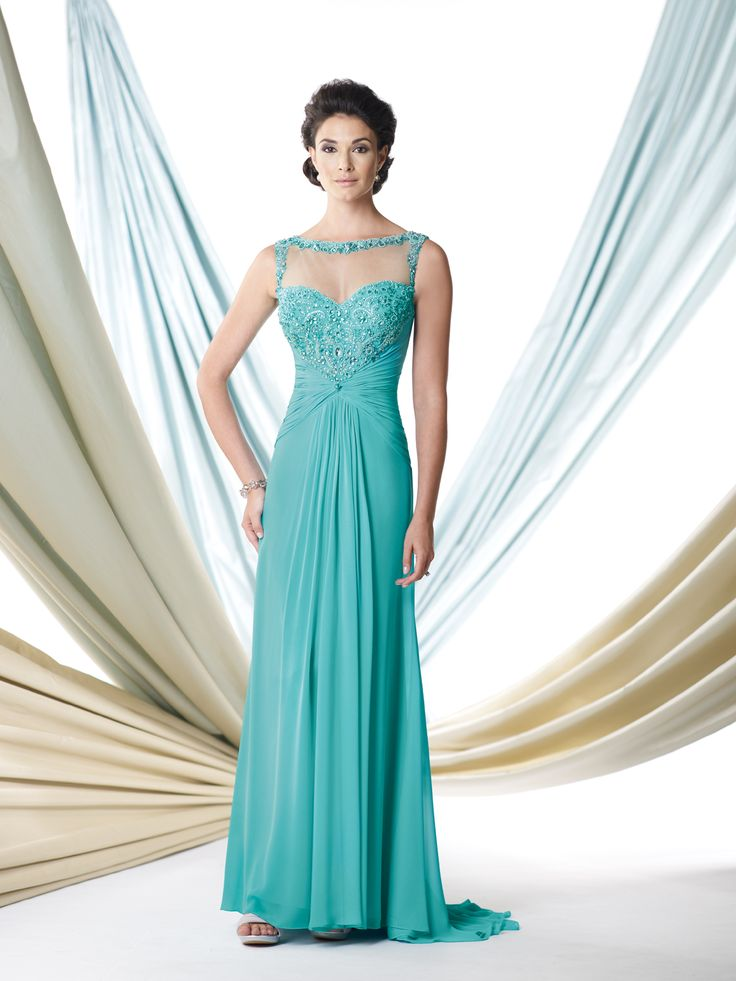 Sleeveless chiffon A-line dress with illusion bateau neckline trimmed with ornate hand-beading, sweetheart bodice encrusted with beading features an unique beaded illusion racer back, midriff and skirt gathered at center, sweep train, suitable as a dress to wear to a wedding. Matching shawl included.Sizes: 4 – 20