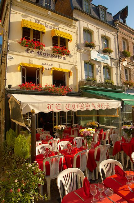 Le Corsaire restaurant withterrace tables set ready for lunch. Honfleur, Normandy, France.