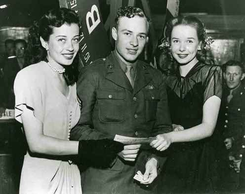 Historic Photograph of Actresses, Gail Russell And Diane Lynn With A Serviceman Who Just Won A $25 War Bond During A Raffle At The Hollywood Canteen.