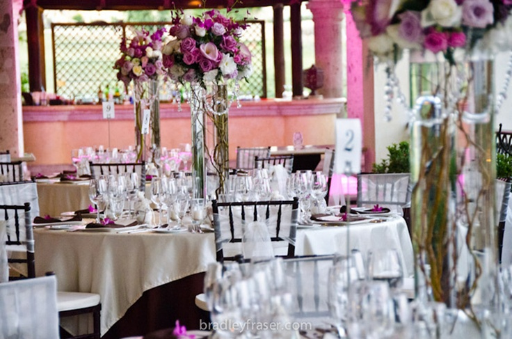 Pink and lavender tablescape with pink lighting by Vivid Occasions