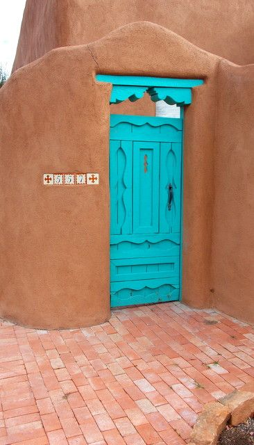 Turquoise courtyard door.....via  ༺Anne H༻ Gorgeous colors!