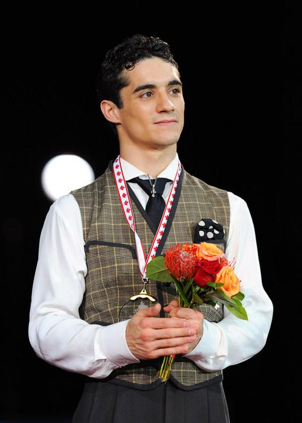 Javier Fernandez with his first ever GOLD grand prix medal!!! Skate Canada 2012.   I gave him his flowers!