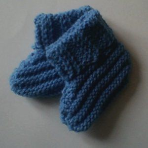 These booties are fit for a prince! The Royal Baby Booties are a gorgeous shade of deep blue and have a handsome stitch design that hug baby's tiny feet in all the right places.