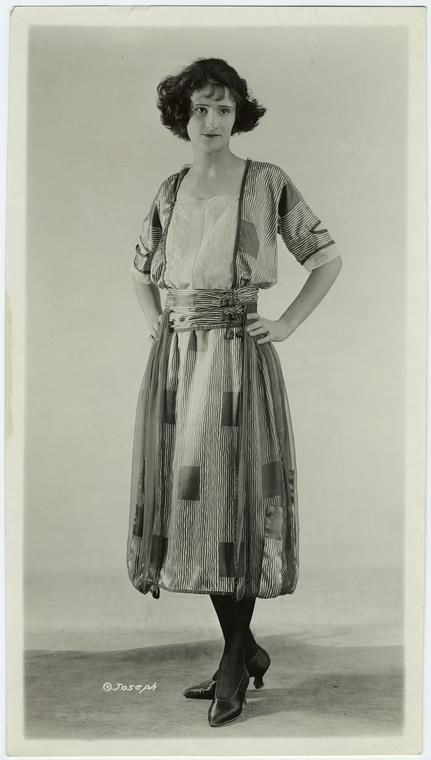 Woman in striped dress 1921 NYPL