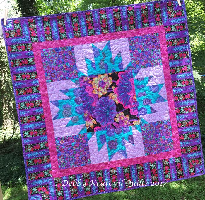 """Finally quilted my Delectable Mountains quilt. Love all these luscious prints and the """"vintage"""" Lille Collection fabric in the star points. 40"""" x 40""""."""
