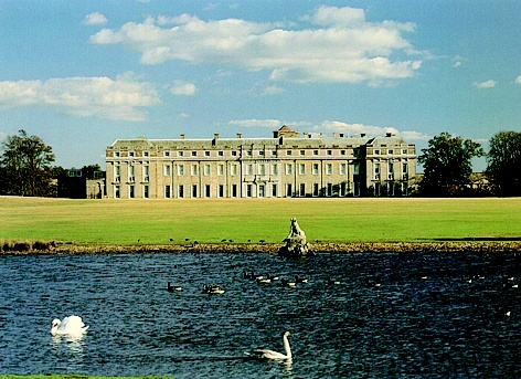 Petworth House, Petworth, West Sussex. Late 17th-century mansion, rebuilt in 1688 by Charles Seymour, 6th Duke of Somerset, altered in 1870's by Anthony Salvin. A fortified manor house founded by Henry de Percy, 13th-century chapel + undercroft of which still survive. Standing in a landscaped park inhabited by largest herd of fallow deer in England, designed by 'Capability' Brown. For the past 250 years the house has been in the hands of the Wyndham family. Handed over to the nation in 1947.