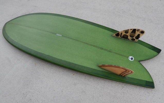 Bottle green tint twin fin surfboard